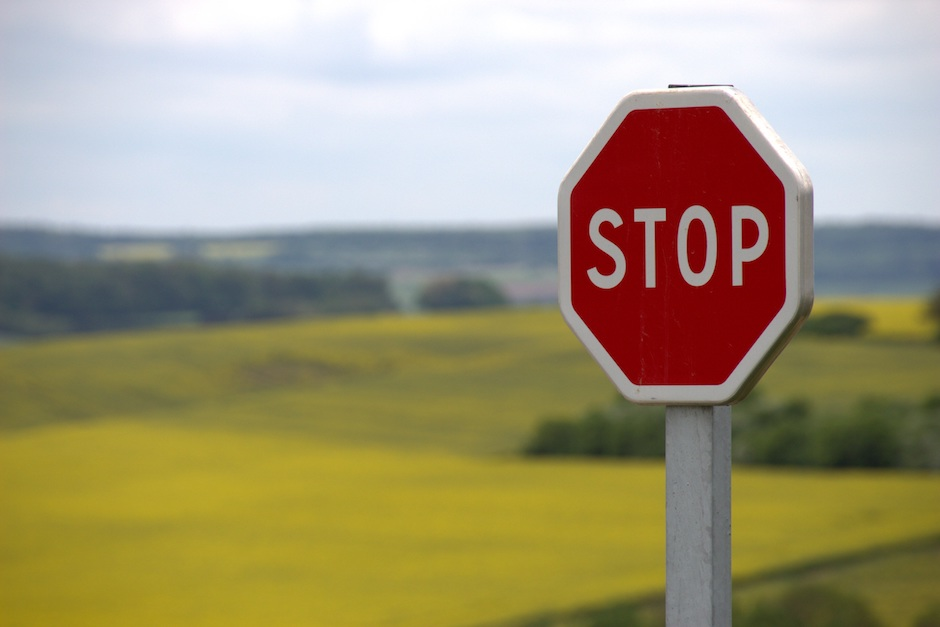 Stop sign in front of a field telling Microsoft to stop stealing the browser
