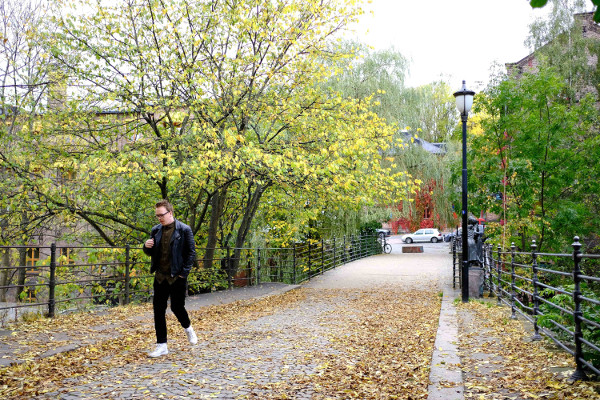A man walks on Beierbrua bridge in autumn.