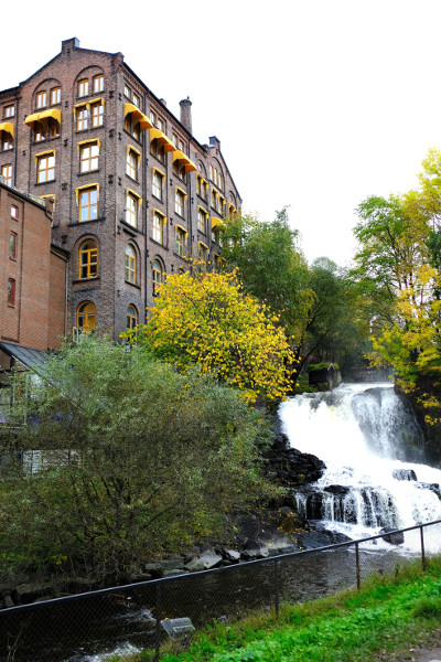 A brick building on Akerselva river and waterfall.