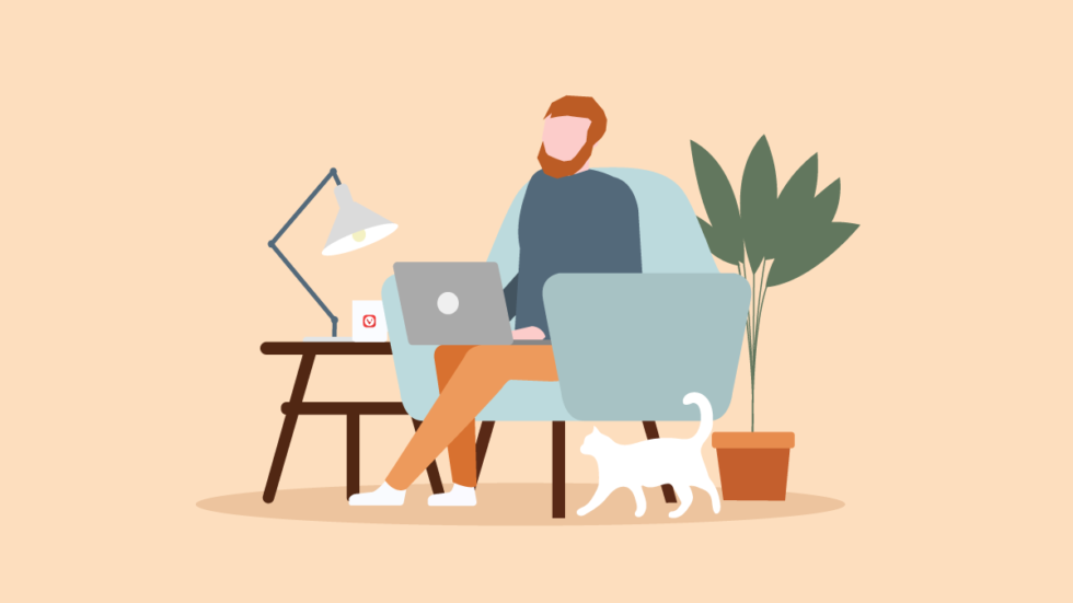 Man on an armchair working remotely.