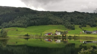 Norwegian farm by a river
