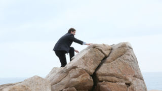 Jon von Tetzchner climbs a mountain.
